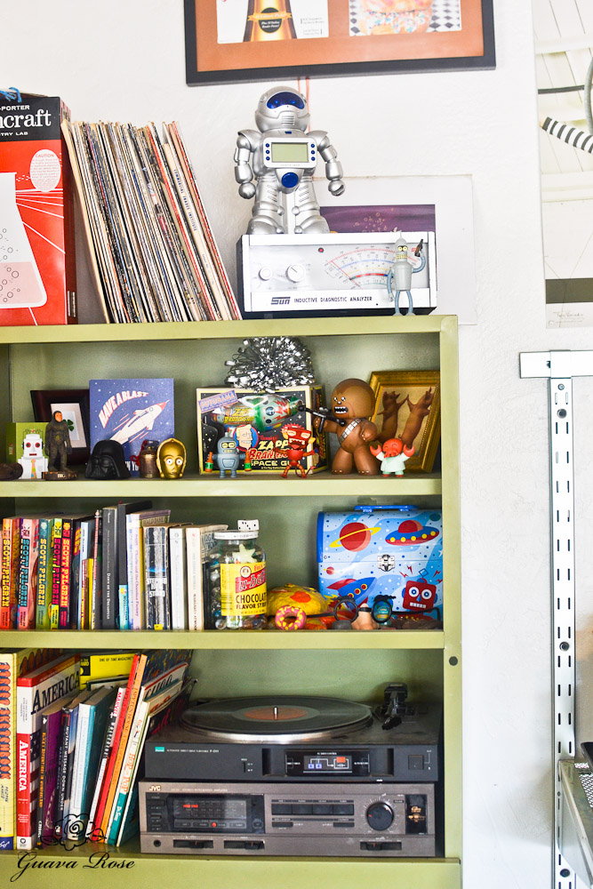 Bookshelf with robots, books, and games