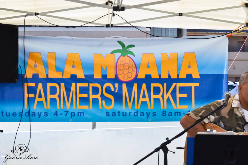 Ala Moana Farmer's Market sign and entertainment