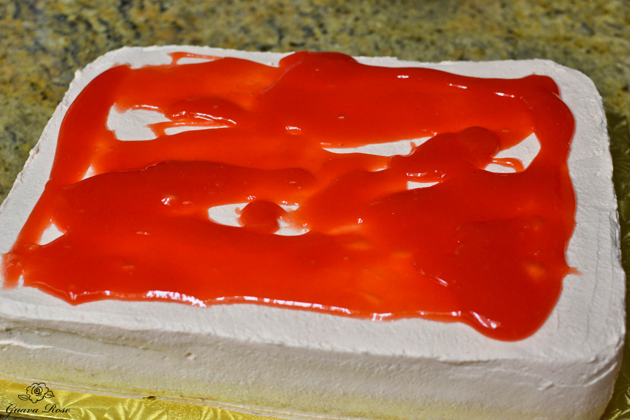 Guava glazed streamed over cake top