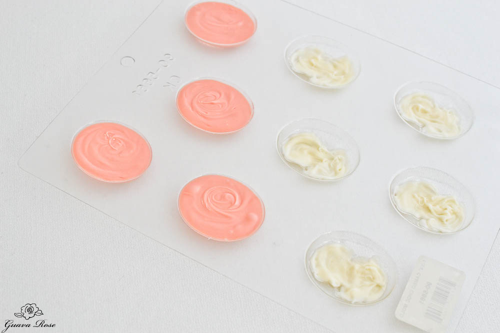 Filling cameo molds with pink chocolate