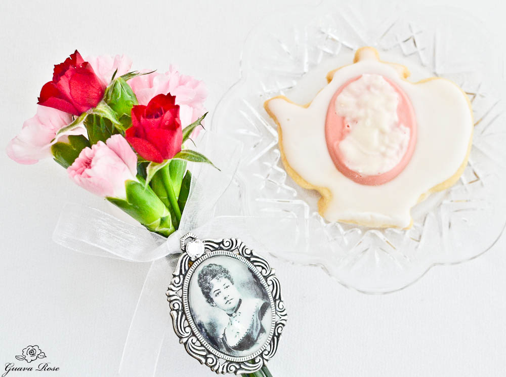Coconut Cream Cameo Cookie w/ flowers & Queen Emma Brooch