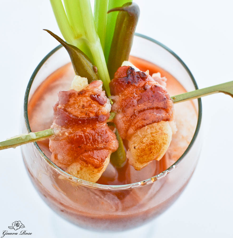 Bacon wrapped mochi over Bloody Mary, close up