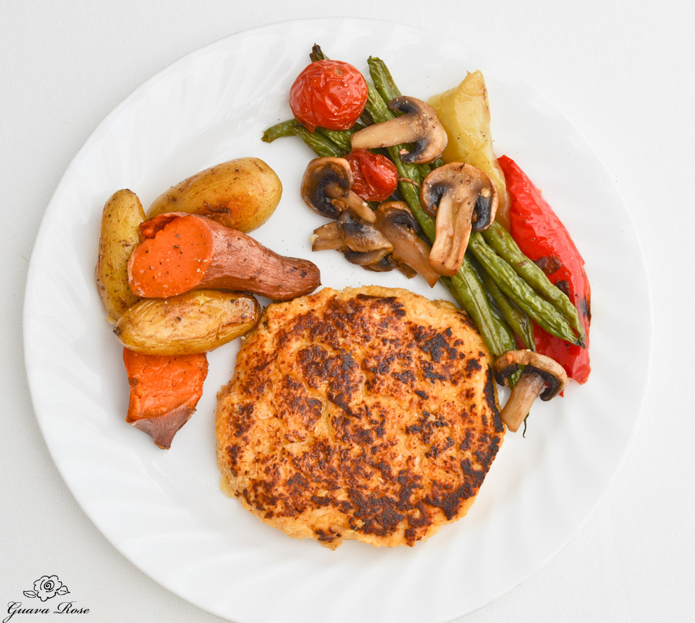 Buffalo Cauliflower Pancakes with roasted vegetables, top view