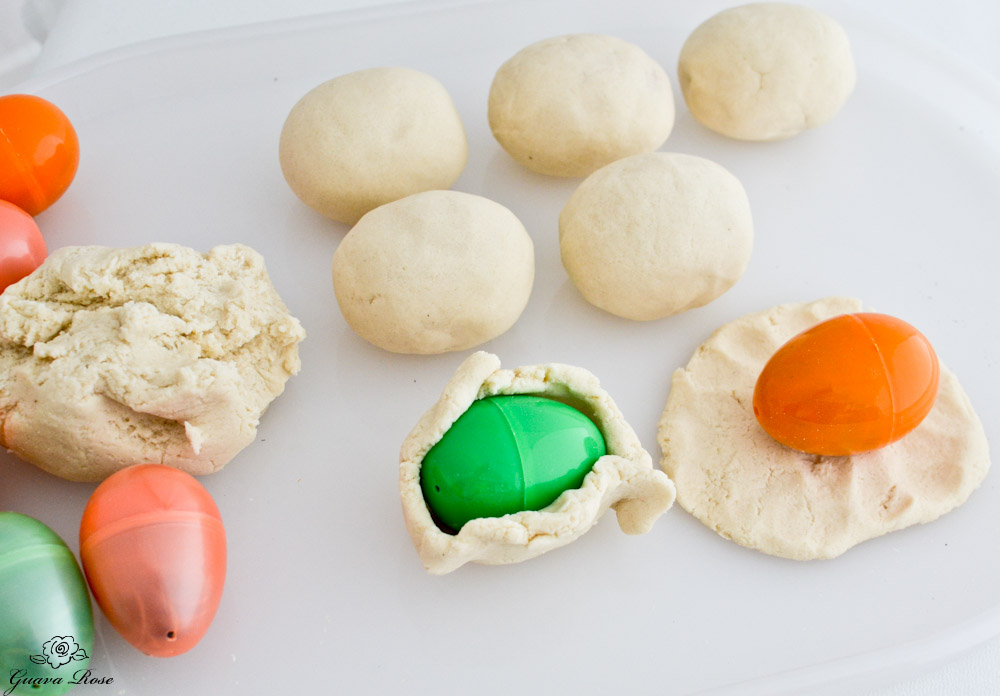 Covering the eggs with dough